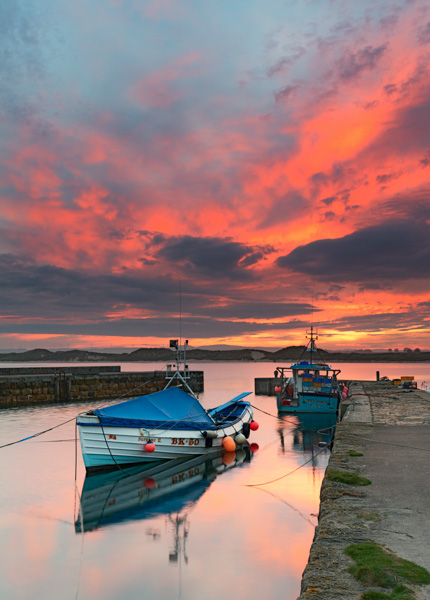 A dramatic sunset over Beadnell harbour